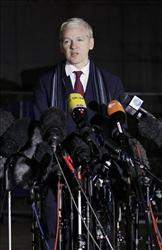 WikiLeaks founder Julian Assange speaks outside Belmarsh Magistrates' Court in London, Tuesday, Feb. 8, 2011.