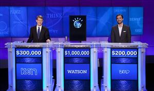 Ken Jennings, left, and Brad Rutter, right, pose with Watson after the end of the challenge.
