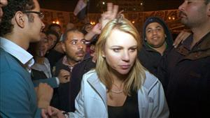 In this Feb. 11, 2001 photo released by CBS, 60 Minutes correspondent Lara Logan is shown covering the reaction in in Cairo's Tahrir Square the day Egyptian President Hosni Mubarak stepped down.