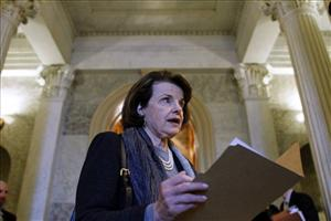 Sen. Dianne Feinstein, D-Calif., looks at a folder near the Senate floor during an unusual Sunday session on Capitol Hill last year.