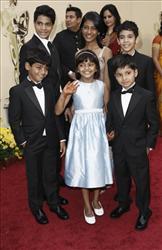 Cast of Slumdog Millionaire, front left, Azharuddin Mohammed Ismail, Rubina Ali, Ayush Mahesh Khedekar, back left, Ashutosh Lobo Gajiwala, Tanvi Ganesh Lonkar and Tanay Hemant Chheda arrive for the Academy Awards Sunday, Feb. 22, 2009.