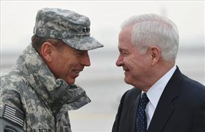 Gen. David Petraeus greets Defense Secretary Robert Gates  upon Gates' arrival in Kabul, Afghanistan, yesterday.