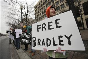 A protester holds a sign during a demonstration outside FBI headquarters in support of U.S. Army Pfc Bradley Manning.