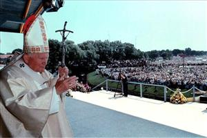 In this Tuesday, June 8, 1999 file photo, Pope John Paul II waves to the faithful as he arrives to celebrate Mass at the bank of Elk River in Elk, Poland.