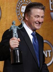 Actor Alec Baldwin poses backstage with the award for actor in a comedy series at the 16th Annual Screen Actors Guild Awards on Saturday, Jan. 23, 2010, in Los Angeles.