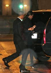 President Barack Obama and first lady Michelle Obama leave The Source restaurant and board their motorcade in the freezing rain after having dinner, Monday, Jan. 17, 2011, in Washington.
