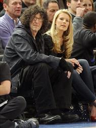 Radio personality Howard Stern, left, and his wife, Beth Ostrosky, watch the New York Knicks play the Miami Heat at Madison Square Garden in New York, Jan. 27, 2011.
