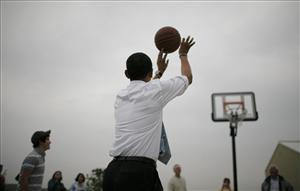 A file photo of Barack Obama shooting hoops.
