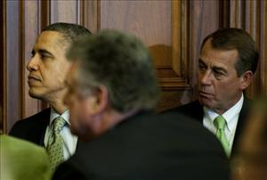 President Obama listens to a cultural performance with Speaker of the House John Boehner during a St. Patrick's Day lunch, March 17, 2011.