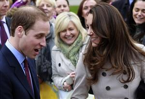 In this Tuesday, March 8, 2011 file photo, Britain's Prince William and Kate Middleton attend the charity Northern Ireland Cancer Fund for Children outside the City Hall in Belfast, Northern Ireland.