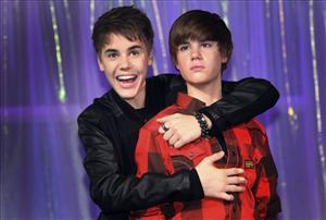 Justin Bieber, left, hugs the new waxwork figure of himself at Madame Tussaud's in London on March 15, 2011.