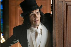 In this film publicity image released by Warner Bros. Pictures, Russell Brand is shown in a scene from Arthur.