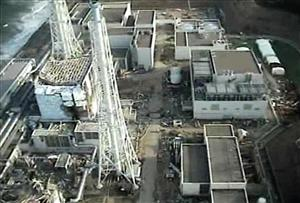 This Sunday, April 10 image shows the damaged reactor building of Unit 4, left, of the tsunami-crippled Fukushima Dai-ichi nuclear power plant.