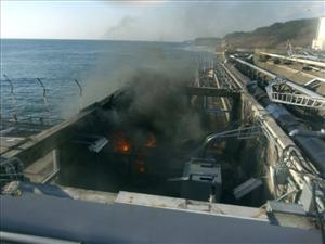 In this photo released by TEPCO, a small fire breaks out from facilities sampling seawater located a few dozen meters from Unit 4 inside the tsunami-crippled Fukushima Dai-ichi nuclear power plant.