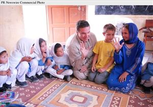 Author Greg Mortenson, his son Khyber, and daughter, Amira Mortenson, with students at Gultori War refugee school, Bromolo Colony, Karakoram mountains.
