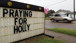 In this April 15, 2011 photo, a sign in Parsons, Tenn., conveys the community's concern for Holly Bobo, a 20-year-old nursing student who went missing Wednesday.