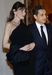 France's President Nicolas Sarkozy, right,, and his wife Carla Bruni-Sarkozy, left, at a State dinner at the Elysee Palace, Wednesday, March 2, 2011.