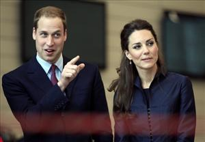 Britain's Prince William and his fiancee Kate Middleton at Darwen Aldridge Community Academy in Darwen, north-west England, on April 11, 2011.