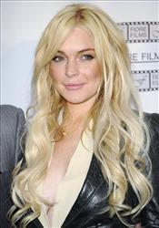 In this April 12, 2011 file photo, actress Lindsay Lohan poses during a news conference for the film Gotti: Three Generations, based on the life of John Gotti, in New York.