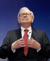 This March 24, 2011 file photo shows billionaire investor Warren Buffett at a news conference in New Delhi, India.