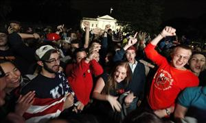 A crowd outside the White House cheers Sunday upon hearing the news that Osama bin Laden is dead.