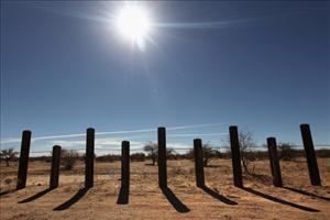 The porous US-Mexico border fence stretches through the Sonoran Desert on January 18, 2011 in the Tohono O'odham Nation, Arizona.