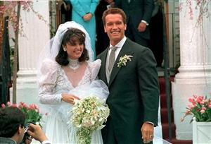 \In an April 25, 1986 file photo Actor Arnold Schwarzenegger poses with his bride Maria Shriver following their wedding ceremony in Hyannis, Mass.