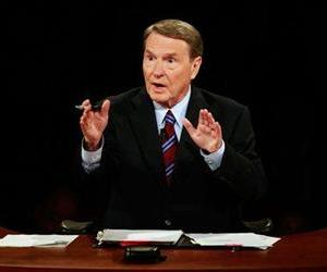 Debate moderator Jim Lehrer asks a question during a debate between Barack Obama and John McCain, Sept. 26, 2008.