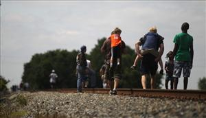 Residents walk along railroad tracks on their way to attempt to catch a glimpse as water is released by the U.S. Army Corps of Engineers at the Morganza Spillway May 14, 2011 in Morganza, Louisiana. The opening of the floodgates for the first time in nearly forty years is...