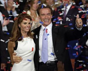 This photo taken Oct. 7, 2003, shows Arnold Schwarzenegger and wife Maria Shriver as they  celebrate his victory in California.