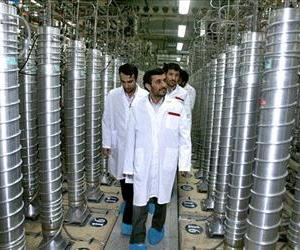 Iranian President Mahmoud Ahmadinejad, center, visits the Natanz Uranium Enrichment Facility in Iran, which is under IAEA monitoring, in this April 8, 2008 file photo.