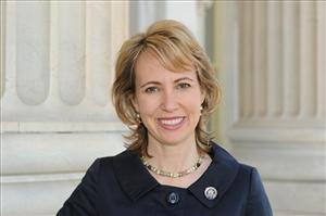 In this March, 2010 file photo, Rep. Gabrielle Giffords, D-Ariz. Giffords is recuperating from implant surgery on her skull following a milestone in her recovery from an assassination attempt.