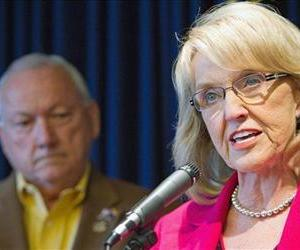 Arizona Gov. Jan Brewer holds a news conference to announce that the state will appeal a ruling against another immigration law to the Supreme Court in this file photo.