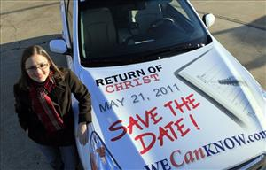 In this Dec. 17, 2010 file photo, Allison Warden poses with her car in Raleigh, N.C., showing a message about the rapture.