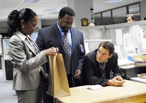 Actors, from left, Sonja Sohn, Wendell Pierce, and  Dominic West are shown in a scene from HBO's The Wire.