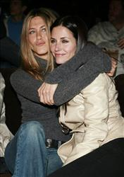 Jennifer Aniston and Courteney Cox pose together at the premiere of The Tripper in Los Angeles on Wednesday, April 11, 2007.