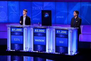 Contestants Ken Jennings and Brad Rutter compete against 'Watson' at a press conference for the Man V. Machine 'Jeopardy!' competition on January 13, 2011 in Yorktown Heights, New York.