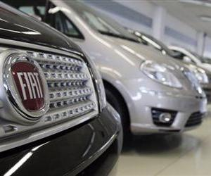 Fiat cars are displayed at a retailer in Milan, Italy, Thursday, April 21, 2011.