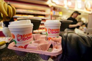 A customer is suing Dunkin' Donuts after she went into diabetic shock from drinking coffee she believed to be artificially sweetened.