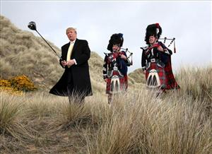 Donald Trump swings a golf club in the sand dunes of the Menie Estate, on the Aberdeenshire coast, Scotland, May 27, 2010, the location of his planned $1.5 billion golf resort.