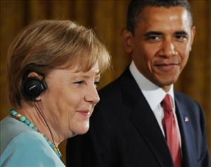 Obama and German Chancellor Angela Merkel hold a joint press conference in the East Room of the White House in Washington, DC, June 7, 2011.