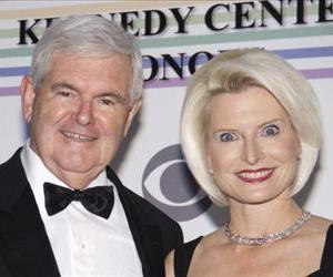 Newt Gingrich and Callista Gingrich pose for photos during a December function in Washington in this file photo.