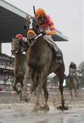 Ruler On Ice, with jockey Jose Valdivia Jr., sprints to the finish line to win the Belmont Stakes horse race Saturday, June 11, 2011, at Belmont Park in Elmont, N.Y.