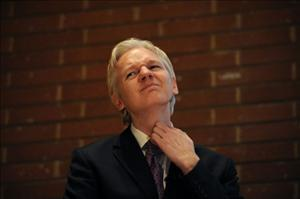 WikiLeaks founder Julian Assange attends a debate on whistle-blowing in London on April 9.