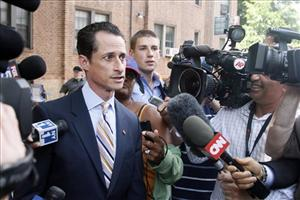 Rep. Anthony Weiner, D-N.Y., leaves his home for his press conference Thursday.