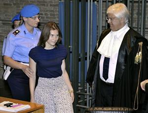 Amanda Knox, second from left, walks past her lawyer Luciano Ghirga, as she arrives in court for the appeal trial in Perugia, Italy, Saturday, June 18, 2011.