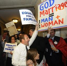Protesters for and against the same-sex marriage bill protest in the halls of the Capitol in Albany, N.Y., Monday, June 20, 2011, as Senate Republicans, who can determine the measure's fate, consider whether to schedule a decisive vote on the issue.
