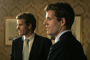 In this July 25, 2007 file photo, twin brothers Cameron, left, and Tyler Winklevoss, founders of ConnectU, talk with reporters following a news conference in Boston.