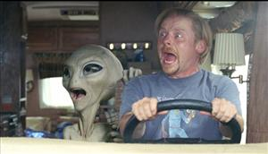 In this film publicity image released by Universal Pictures, Paul the alien, voiced by Seth Rogen, left, and Simon Pegg are shown in a scene from the film, Paul.