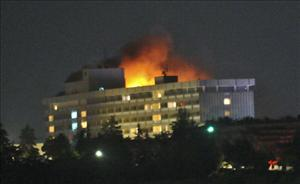 Smoke and flames light up the night from a blaze at the Intercontinental hotel after an attack on the hotel by Taliban fighters in Kabul on June 29, 2011.